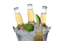 Beer Bucket with Lime and Bottle in front Stock Photo