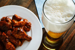 Beer with buffalo wings Royalty Free Stock Image
