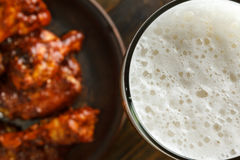 Beer with buffalo wings Royalty Free Stock Photo