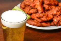 Beer and Buffalo Wings. Beer and Spicy Buffalo Chicken Wings stock photos