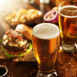Beer and burgers on wooden table royalty free stock photo