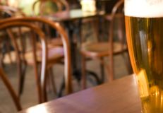 Beer in cafe. A glass of beer in cafe Royalty Free Stock Photos