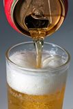 Beer can. Pouring beer in a glass Stock Images
