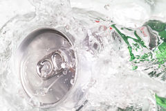 Beer can splashing water Royalty Free Stock Photography