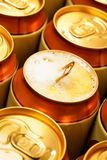 Beer cans. Opened beer can with froth. Shallow DOF Royalty Free Stock Photos