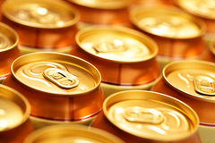 Beer cans. Gold beer cans close up. Shallow DOF Stock Image