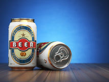 Beer cans on blue  background Royalty Free Stock Images