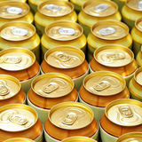 Beer cans. A lot of gold beer cans. Shallow DOF Royalty Free Stock Photography