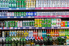 Beer cans in Supermarket shelf Stock Image