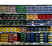 Beer Cans On Supermarket Shelf. At Tesco Malaysia Royalty Free Stock Photos