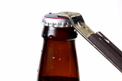 Beer Cap. Bottle Opener and a Beer Royalty Free Stock Photography
