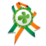 Beer cap with clover leaf and flag Stock Photography