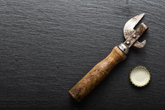 Beer cap and opener Royalty Free Stock Photos