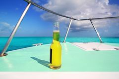 Beer on Caribbean boat bow deck turquoise sea Royalty Free Stock Image