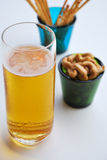 Beer,cashew nuts in green glass and snack Royalty Free Stock Image