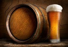 Beer in cask and glass Royalty Free Stock Photos