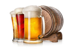 Beer and cask. Beer and wooden cask isolated on a white background Royalty Free Stock Images