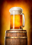 Beer with cask on yellow Stock Image