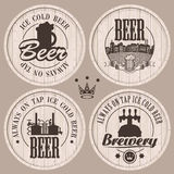 Beer casks. Set of labels to beer on wooden casks Stock Photos
