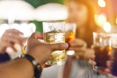 Beer cheers. Hand of friends holding beer glass for celebration Royalty Free Stock Photos