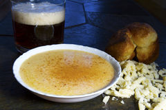 Beer Cheese Soup with Crumbled Cheese and Popover Royalty Free Stock Images