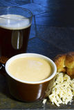 Beer Cheese Soup with Popover Stock Photo
