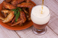 Beer and chicken wings Stock Images
