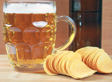 Beer and chips Stock Images