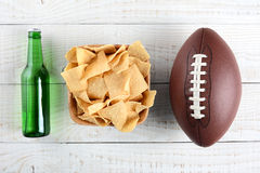 Beer, Chips and Football Royalty Free Stock Photos