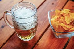 Beer and chips Stock Photos