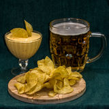 Beer, chips and the sauce. Still life: beer, chips and the sauce royalty free stock photos