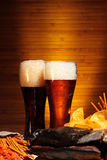 Beer with chips and snacks Stock Image