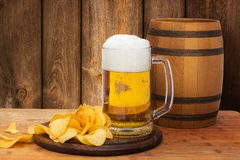 Beer and chips on wooden background. Beer and chips on wooden background design stock image