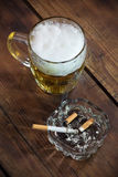 Beer and a cigarette Stock Images