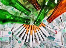 Beer and Cigarettes on the Money Royalty Free Stock Photos