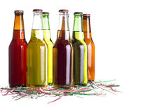 Beer with Cinco De Mayo Confetti. Unlabeled beers or cervesa with Cinco De Mayo holiday confetti Stock Images