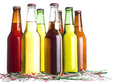 Beer with Cinco De Mayo Confetti. Unlabeled beers or cervesa with Cinco De Mayo holiday confetti Stock Image