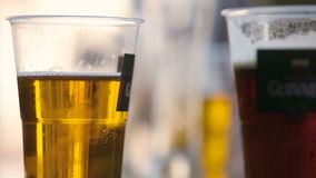 Beer. Close-up of a beer with a person not at the bottom stock footage