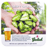 Beer coaster for advertising for Grolsch volmout. Royalty Free Stock Photo