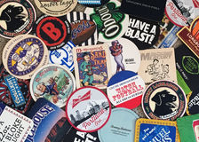 Beer coasters of many places Royalty Free Stock Image