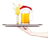 Beer with cocktail on a silver waitress tray Royalty Free Stock Photos