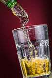 Beer 2. Cold beer swirling into a transparent glass. Photo made in studio Stock Photo