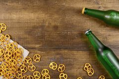 Beer and crackers on a wooden table Stock Photography