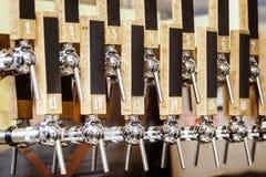 Beer cranes in bar Stock Photos