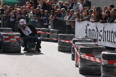 Beer crate racing. In the second race of beer cases in Hohentann (area of Landshut, Germany), more than 25 pilots have measured in  there self-built  beer cases Royalty Free Stock Images
