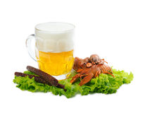 Beer with crayfish and sausages. Foamy beer with red crayfish and greasy sausages Stock Photo