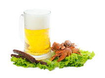 Beer with crayfish and sausages. Foamy beer with red crayfish and greasy sausages Stock Photography