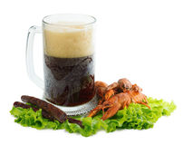 Beer with crayfish and sausages. Foamy beer with red crayfish and greasy sausages Stock Images