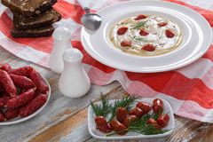 Beer and cream winter Soup with fried mini salami Sausages Stock Images