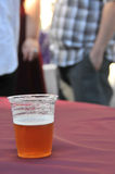 Beer cup on table at a party Royalty Free Stock Images